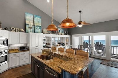 Large Granite Kitchen with Stainless steel appliances.