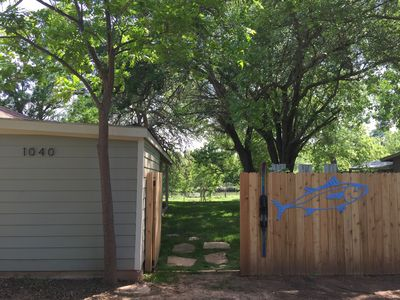 Welcome! Large 1/3 acre yard is fully fenced, except by the water!