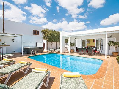 Photo for Stylish villa in walking distance to a lively resort, with a private pool & terrace for alfresco living