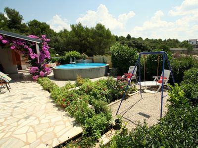 Photo for This 3-bedroom villa for up to 8 guests is located in Brodarica and has a private swimming pool, air