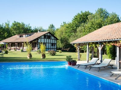 Photo for A beautiful balance between sea and country side with this superb, charming house with swimming pool, pool house, 10 minutes away from the beaches