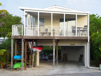 Front View of Home with covered deck and covered parking below
