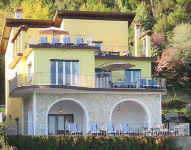 Photo for White Apartment: 7 beds, terrace with portico on the river and berth