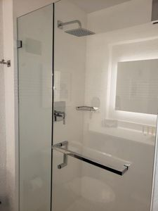 Bathroom with a shower. The essential kit and towels are provided!