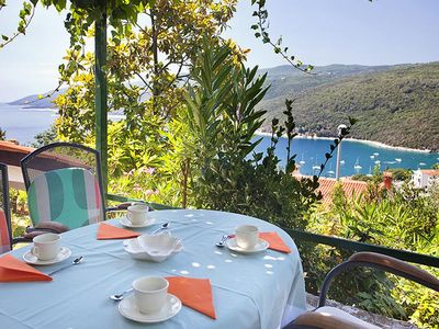 Photo for Two bedroom apartment with terrace and sea view Rabac, Labin (A-7622-a)