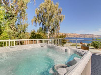 Enjoy incredible lake views and a private hot tub from this amazing home