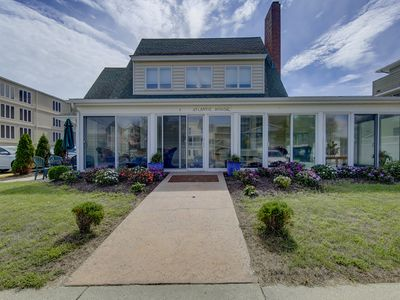Photo for 4 Maryland Ave  - Large home steps from ocean. Wrap around screened front porch for ocean breezes and ocean/boardwalk view. 4 bed 3 bath Use of pool and beach equipment. Off street parking. Sleeps 14. **Includes Linens + Towels**