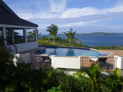 Photo for Modern Villa with Exceptional Views of Coral Strewn Waters- Resort Privileges