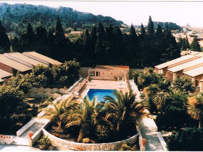 Photo for Gitelacapelle with 2 swimming pool bedrooms, 10mm from wild beaches, tropical setting ....