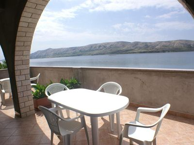 Photo for Two bedroom apartment with terrace and sea view Zubovići (Pag)
