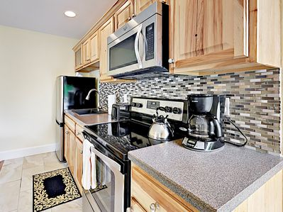 Kitchen - The kitchen includes a stainless steel fridge/freezer, stove/oven, and microwave