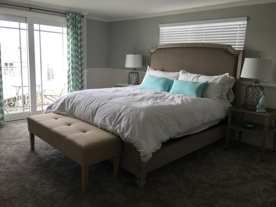 Master bedroom with king bed & french slider opening to balcony w/ bath attached