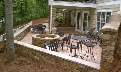Outdoor fire pit area on one side with new outdoor TV recently added.