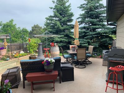 Large, private patio with plenty of furniture and gas grill.