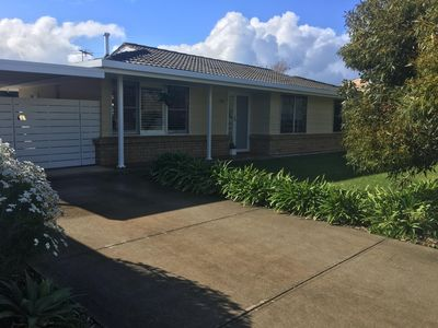 Front of house with lockable gates to single carport