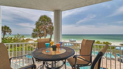 Photo for Beautiful sunset views from the direct gulf front balcony and just steps from the beach!