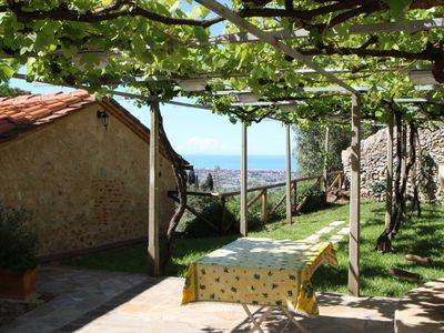 Photo for Casa Fabrizia - Home with sea view, private garden, rustical touch, near Camaiore