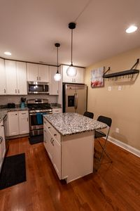 Photo for Beautiful newly remodeled 3/2.5 home and roof deck w/ wonderful views of harbor!