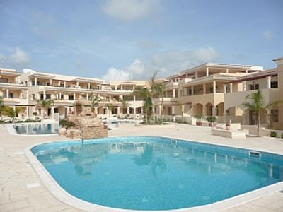 Photo for Luxury Apartment, full air-con, stunning balcony overlooking 2 pools