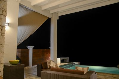 Large covered patio extends the day into night