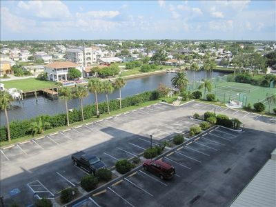 Tennis courts, large parking lot and canal views