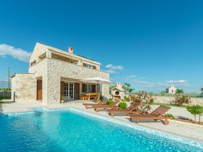 Photo for Stone villa with pool, 500 meters from the sand beach, barbecue and children's playground