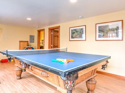 Managed by Bloomer Estates Vacation Rentals.  The downstairs recreation room has a pool table with a ping pong table top