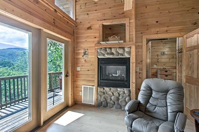 You'll be greeted by natural wood paneling, homey decor, and inescapable views.