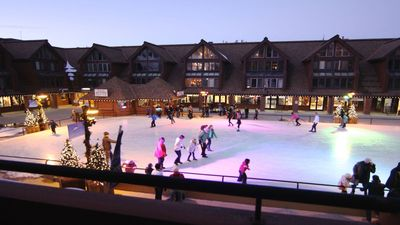 Magical view of ice skaters and the mountains from your private balcony