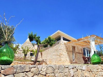 Photo for Detached villa with private swimming pool on a hill with sea view