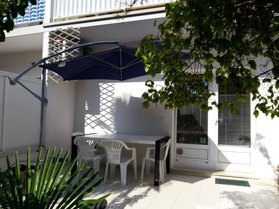 Photo for Apartment with terrace and garden in the center and near the beach