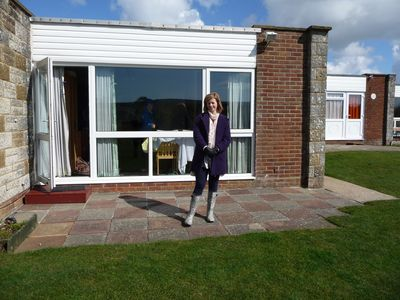Photo for 2 Bedroom holiday bungalow with sea views to the needles, 3 min from sandy beach