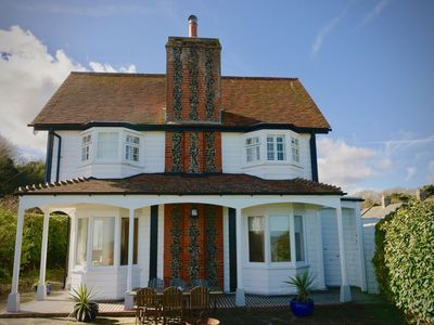 Photo for A luxury coastal holiday home with panoramic views of the English Channel