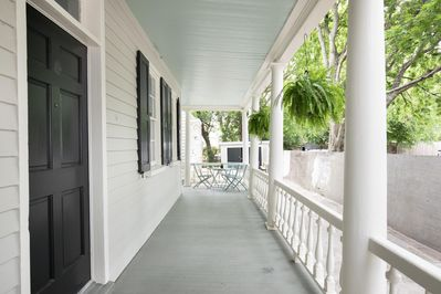 Beautiful Porch With Seating Perfect for Cocktails or Coffee