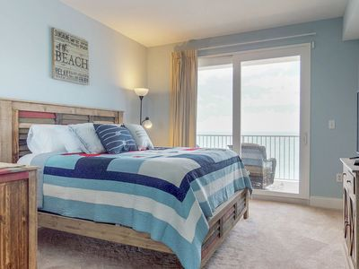 Photo for Fantastic beach and lake view condo with shared pools and hot tub!