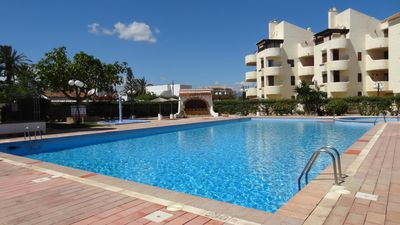 Photo for Modern apartment, on the beach, air conditioning, WIFI, large communal pool