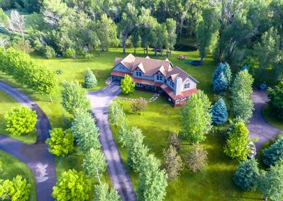 Aerial View of Spring Creek Estate.  Two acres and trout pond and huge flat yard