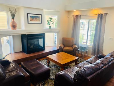 Front living room with comfortable leather couch and chairs