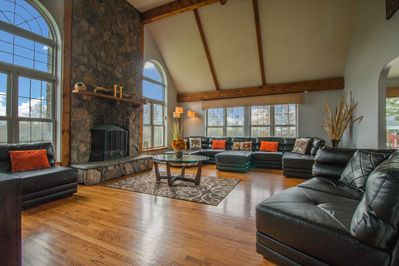 Huge real stone fire place, soaring ceilings, plenty of seating for everyone!