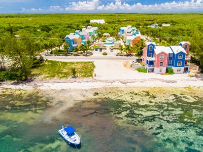 Photo for Tranquil Caribbean Home in East End Across From the Ocean