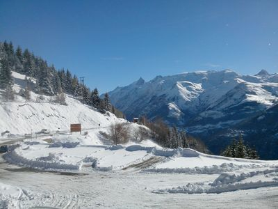 Photo for 65m2 apartment in a quiet and ski-in ski-out area of ​​Alpe Huez