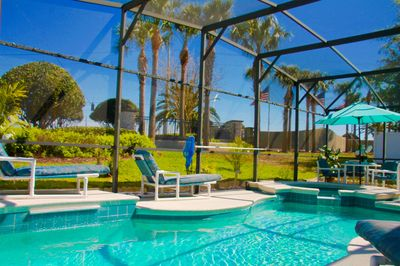Beautiful Private Pool & Spa Sitting and Eating area with lots of Palm trees,