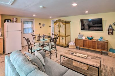 The bright and beachy interior boasts a queen bed and 1 full bathroom!