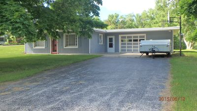 Photo for Cozy cottage minutes from Lake Michigan, pristine beaches, canoeing, fishing.