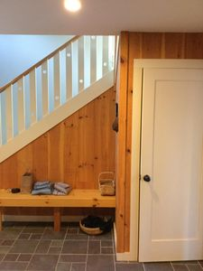 Mudroom and stairs to loft and door to lower level.
