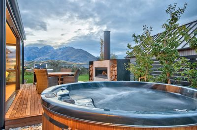 Sit back and relax in our outdoor hot tub while enjoying the view