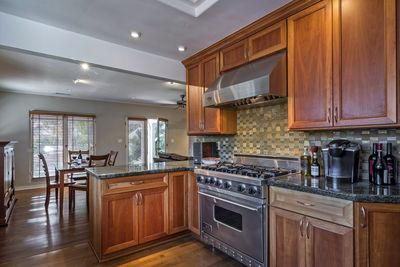 Clean kitchen with stainless steel appliances and every amenity you need during your stay!