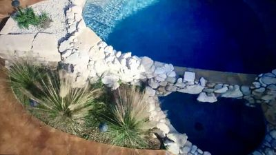 Pool - The backyard is professionally landscaped and the custom plunge pool provides a cool relief from the summer sun.