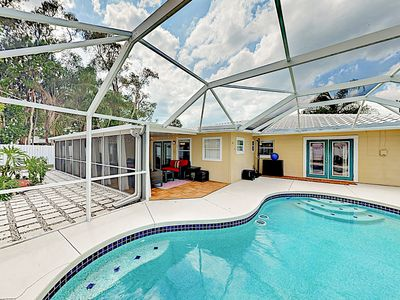Photo for New Listing! Coastal Chic Oasis w/ Private Screened Pool, Patio & Grill
