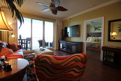 Spacious living area with large flat panel TV